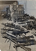 Machine Guns Seized in Arsenal Raid by T-Men