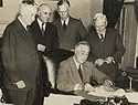 Roosevelt Signs the Draft Bill